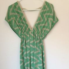 XS bebe dress Shimmery, green and silver chevron dress with low v cut in front and back. Length is suitable for a party or cocktail occasion.  Excellent condition. bebe Dresses