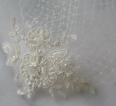 This is a definite possibility depending on my dress. Either way it is simply lovely! Ivory Birdcage Veil and Lace Bridal Fascinator, Vintage Style Bandeau Birdcage Wedding Veil and Lace Hair Clip - KAYLA