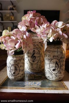 Easy DIY Sheet Music Mason Jar Vases Girl, Just DIY! is part of Mason jar crafts diy - These lovely sheet music mason jar vases are perfect for any room in your house They are an easy craft and perfect for homemade gift ideas Pot Mason Diy, Mason Jar Vases, Mason Jar Crafts, Coffee Jar Crafts, Diy Simple, Easy Diy, Simple Gifts, Sheet Music Crafts, Sheet Music Decor