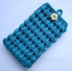 Love the texture of this free crochet pattern, will try this soon.    http://lovestitches.blogspot.com/2011/07/pattern-puffy-cell-phone-cozy.html