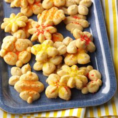 Orange Spritz Cookies Recipe -Brown sugar gives these spritz cookies a lovely light caramel tint. This variation has a rich buttery shortbread taste and texture with a hint of orange flavor. They are a delightful addition to my holiday cookie tray. -Sean Fleming, St. Charles, Illinois