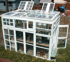 DIY:  Greenhouse built from salvaged windows! Not a beginner's project - plans & materials list on link. Cost was $300.