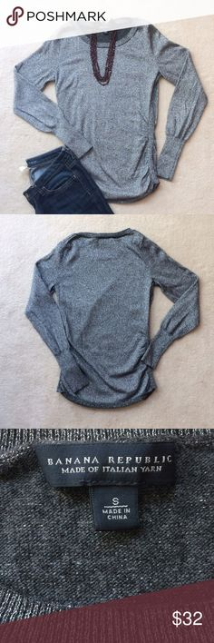 Banana Republic Silver Sparkle Sweater Sparkle and shine! This sweater is ready for all your holiday parties. The top is a nylon/ wool/ polyester/ cashmere/ metallic blend. It has a crew neck and ruche side. Banana Republic Sweaters Crew & Scoop Necks