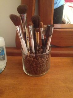 DIY coffee bean makeup brush holder.  Old candle jar from bath and body works