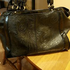 Black Shoulder bag This is by Madi Claire. It has three zippered pockets two on the inside and one on the back. There is a pocket on the back of the bag to fit a smartphone,which fits my Samsung Galaxy S6 edge perfectly. It is a very nice bag used for a couple of month. Bags Shoulder Bags