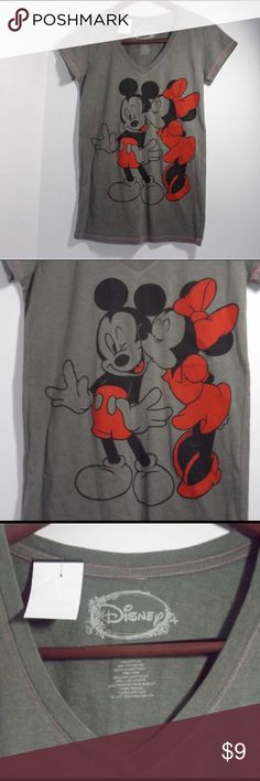 Disney Minnie and Mickey Mouse gray shirt sleeve. This shirt is flawless and features the iconic Disney characters Mickey and Minnie Mouse. This shirt is super easy to pair with almost anything you have in your closet already. Which makes it easy to wear when ever and where ever. This shirt is a timeless piece and will always be in style. Disney Tops Tees - Short Sleeve