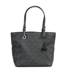 You could easily stash your life in this roomy zip-top tote from MICHAEL Michael Kors. The Signature tote features interior zip and slip pockets for small essentials, while the exterior showcases two large open pockets for easy-to-grab items