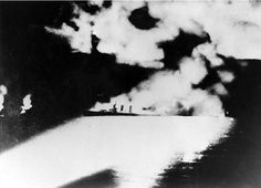 The US cruiser USS Quincy subsequently caught fire and sank as a result of the attack of Japanese cruisers. The flames on the left side of the image are probably the American cruiser USS Vincennes, which also caught fire because of the confrontation