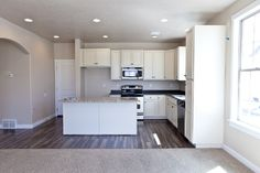 Look at what we have available for prospective residents of Salt Lake County, Utah! Contact Liberty Homes for more information! Living Room Hardwood Floors, Hardwood Floor Colors, Maple Cabinets, White Cabinets, Liberty Home, Utah Home Builders, Kitchen Island Bar, Wood Laminate Flooring, Wide Plank