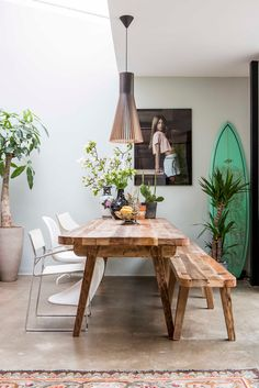 Inspiring Space - the mix of furniture around the table is great. One long bench and three bright white chairs.