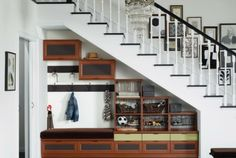 Let California Closets help you design playroom storage options that solve your kids' space organization needs with customized solutions. Call us today. Staircase Storage, Stair Storage, Staircase Design, Stair Design, Storage Shelving, Entryway Storage, Shelving Ideas, Space Under Stairs, Under Stairs Cupboard