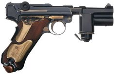 Luger Parabellum RSD night pistol Manufactured by Deutsche Waffen- und Munitionsfabriken AG c.~1942 - serial number 1110T. 7,65x21mm Parabellum tracer rounds, eight-round removable box magazine, toggle-lock short recoil semi-automatic, manual and grip safeties, anodized brass flashlight barrel sleeve with battery slot.