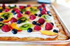 Fruit pizza... fruit, cream cheese, marshmallow fluff and sugar cookie dough?! Oh yes please!