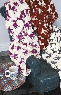 A comfy setting for winter | Deer print plush throw.