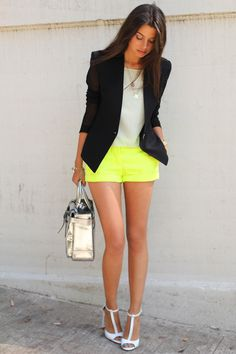 fluoro yellow shorts, Helmut Lang blazer with sheer sleeves, metallic silver Boxer tote.