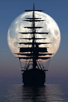 Old sailing ship in front of the moon