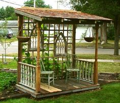 Yard Art~ Make a free Standing Garden Porch made of old recycled materials. I love the old odd shaped windows, porch and stair railings, rusted tin, etc. What a fun place to hang out!