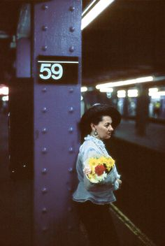 Street photography: © Ferdinando Scianna - USA. New York. Woman with flowers in the subway