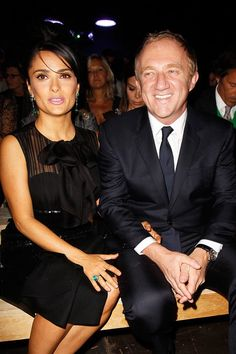Salma Hayek in Saint Laurent and Francois Henri Pinault at Saint Laurent Spring 2013 RTW