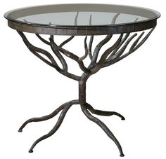"""Heavy metal never looked this good! Delicate twigs form the hand-forged bronze metal base and legs of this glass topped accent table. Even if space is limited in your home, the wispy see-through appeal gives this piece a very small footprint. Product Specifications Uttermost  Sold By Fratantoni Lifestyles   Width 37.75"""" Depth 37.75"""" Height 31.0"""""""