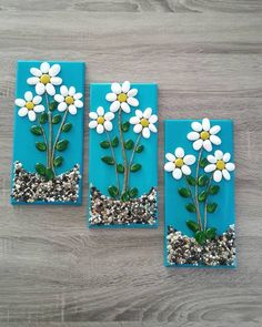 A unique pebble collage. Hand painted beach pebble flowers, the stems are small pieces of painted driftwood. All of this is securely glued to a piece of reclaimed wood with a partially painted blue background, then finally a mat varnish top coating. Stone Crafts, Rock Crafts, Diy Home Crafts, Crafts For Kids, Arts And Crafts, Paper Crafts, Painted Driftwood, Driftwood Art, Pista Shell Crafts