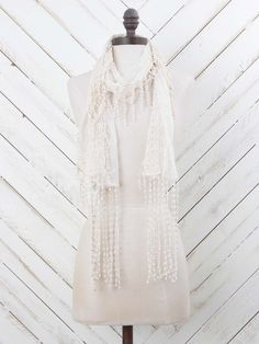 Add this beautiful lace scarf to your outfit for a romantic look! The crochet trim is a perfect add to this scarf to help complete your look!