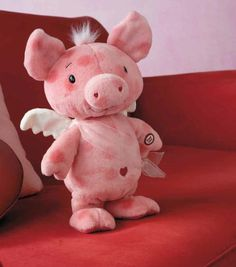 """CUPIG - A pig with wings who shuffles and sings a parody of """"The Cupid Shuffle"""" He also shakes his belly while singing."""" 11"""" h. LPR3848  $15.95 with each purchase of 3 Hallmark cards (regularly $32.95)."""