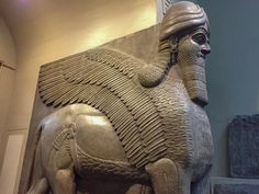 Human headed winged lion - British Museum they originally formed the entrance to the throne room of King Ashurnasirpal II (883-859BC) at Nimrud in northern Iraq. They were seen as protection from demons, and you can certainly see why; you can see the power and intimidation in the beautiful carving. Even more impressive is the perspective; the statue actually has five legs, so it looks correct from either the front or side.