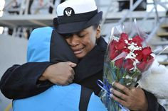 NORFOLK (Nov. 15, 2014) Culinary Specialist 2nd Class Tikea Via hugs a loved one on the pier after disembarking the guided-missile destroyer USS Truxtun (DDG 103). The ship is returning to Naval Station Norfolk after a nine-month deployment in support of maritime security operations and theater security cooperation efforts in the U.S. 5th and 6th Fleet areas of responsibility. (U.S. Navy photo by Mass Communication Specialist 1st Class Shannon Barnwell/Released)