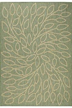 I've been looking for an outdoor rug for our patio.  Love this look, and it flows from indoor decor.