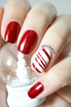 Candy cane feature nail....Super cute for Christmas or that trip to the North Pole!