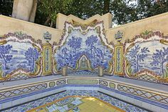 Elaborate Portuguese tiling decorates a patio area.