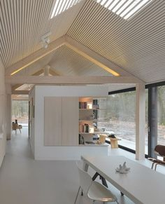 Oisterwijk The Netherlands, 2010 Interior design Modest in its appearance towards the outside, this lengthy residence has a beautiful outlook on the woodlands of the natural reserve that it stands within. The shape of the house is deceptively simple, as