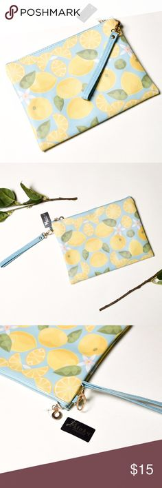 NWT Super Cute Blue/Yellow Lemon Print Pouch Bag NWT super cute small bag, can be used as a makeup bag or just a cool accessory for any outfit! Minky Bags Cosmetic Bags & Cases