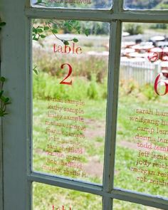 @Amberle Tannahill ... seating plans for wedding placed onto separate window panes. thought you might like it