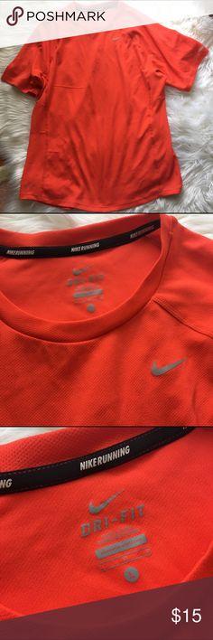 Neon Orange Nike Dri Fit running shirt L Bright orange fitted Nike Dri Fit running top. Size large. Slight pull on left arm as pictured. Nike Shirts