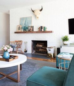 Modern white fireplace with teal accents