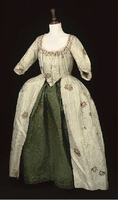 Pale green striped open robe and petticoat, first half of 18th century, with some later alterations.