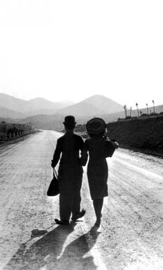 Charlie Chaplin- This is my absolute favorite pic of Chaplin. He always walks away into the sunset alone... this is the only time he walks away with love  :)