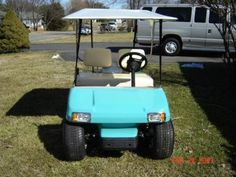 Golf cart painted tropical turquoise
