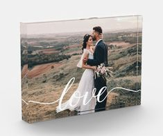 """Wedding Love Script Personalized Photo Gift Using a beautiful and modern script for the word """"Love"""", this newlywed photo block can be easily personalized with their own favorite wedding day photo. An elegant photo block to be cherished and displayed, a modern photo frame option. A great gift for their first Christmas. Wedding Anniversary, Wedding Day, First Christmas Married, Photo Blocks, Personalized Photo Gifts, Couple Gifts, Newlyweds, Christmas Gifts, Great Gifts"""