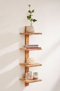 tiered floating wooden shelf unit