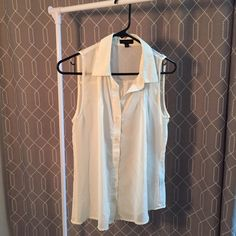 Cream sleeveless button down Cream colored sheer sleeveless button down. Great condition and only worn once or twice! Mine Tops Button Down Shirts
