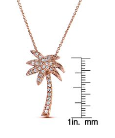 Rose Gold & Cubic Zirconia Palm Tree Pendant Necklace. - . $16.99 Compare at $40.00  . Product Description:  Bold and fabulous, this eye-catching palm tree design glitters from your neckline with rich cubic zirconia accents.      Chain: 18'' L  .     Pendant: 17 mm W x 27 mm L  .     Spring ring clasp  .     18k rose gold-plated brass / cubic zirconia  .     Carat: 0.70 tw cubic zirconia  .     Imported