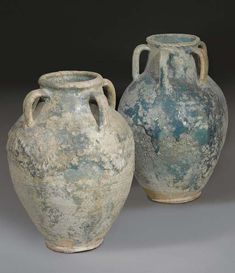 TWO POST SASSANIAN TURQUOISE GLAZED POTTERY JARS -  8TH CENTURY A.D.
