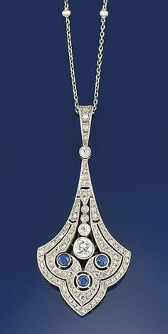 A diamond and sapphire pendant necklace  The pendant of trefoil pierced panel design set in the centre with a single claw-set old brilliant-cut diamond above collet sapphire three stone motifs within rose-cut diamond double-row border, to a diamond suspension loop with diamond single stone connecting link and trace-link neckchain with seed pearl spacers