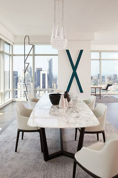 interiors, interior design, home decor, decorating ideas, modern luxury, white spaces, letter decor, marble tables, dining room inspiration