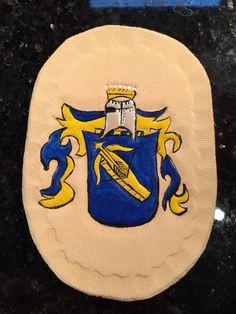 Wappen auf Leder