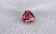 2.92ct Malaya Color Change Garnet custom cut by Ryan Quantz. Very lightly included, untreated. 8.72mm. Ryan says this gem is perhaps the most lively gem he's ever cut to date. Textbook example of Malaya color change garnet.