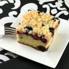 Lemon blackberry buckle with a crumb topping and lemon syrup.
